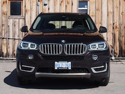 2014 BMW X5 xDrive 35i Sparking Brown Metallic front led headlights on