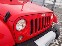 2015 Jeep Wrangler Unlimited Sahara front closeup red